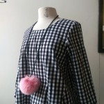 Gingham duck top $158, Pink Pom-Pom on an onyx strand $98