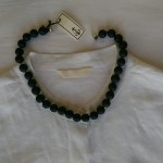 White linen tails shirt detail $189, brushed onyx beads $98